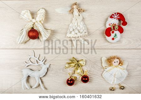Collection of Christmas toys and figures on wood backgroubd