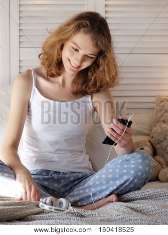 lifestyle and people concept: beautiful content girl in pajamas
