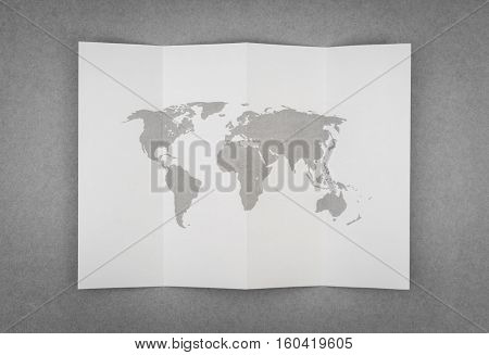 Paper folded with world map