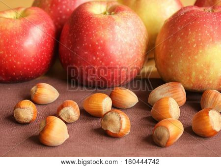 Fresh hazelnuts and apples close up. Autumn food