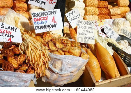 Traditional polish smoked cheese oscypek on outdoor market in Zakopane