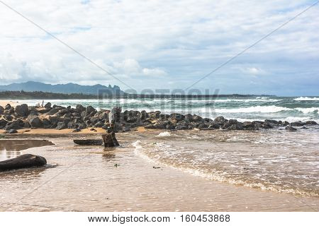 Sand beach along Lihue coast in Kauai, Hawaii