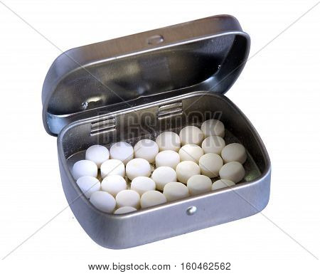 Metallic silver pillbox with white pills isolated on white background