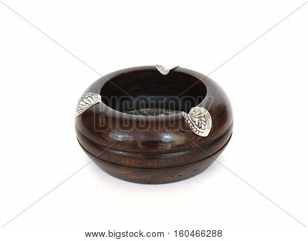 Empty wooden ashtray with metal inserts on white background