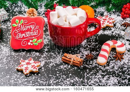 Beautiful Cup Of Marshmallows, Gingerbread With Christmas Tree Branch, Snow, Decor On Black Backgrou