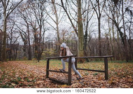 Women stretching outdoor cross training workout, autumn time