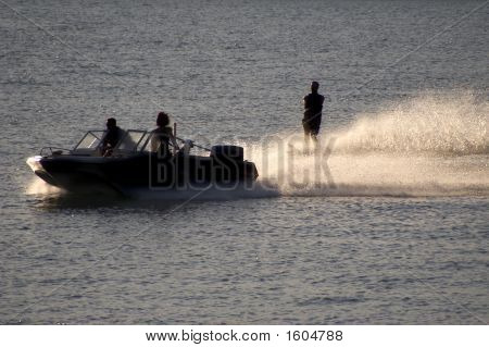 Water Skier With Boat And Dog