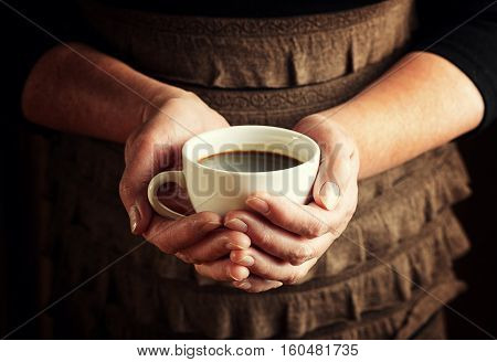 Hands Of Senior Woman Holding Cup Of Coffee