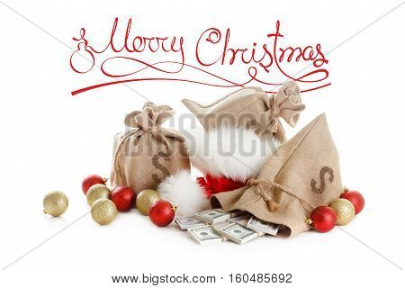 Christmas concept gifts. Money santa claus cap and balls isolated on white background. Stack of dollar currency usd.