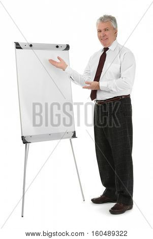 Senior businessman with flip chart on white background