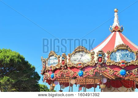 Saint-Tropez France August 21 2016: Detail on vintage Carousel canopy depicting circus and freak show acts