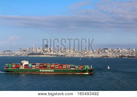 San Francisco CA USA - MAY 23 2015: Cargo ship pass by San Francisco bay on May 23 2015 in San Francisco. SF is the most densely settled large city in California and the second-most in US.