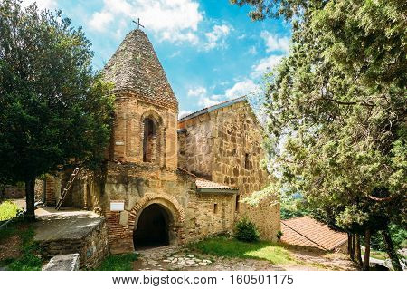 Mtskheta, Georgia. The Church Of St. John The Baptist, The Earliest Stone Building Of Shio-Mgvime Monastery, Medieval Monastic Complex With Carved Caves In Sunny Spring.
