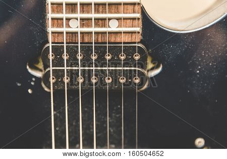 Dusty seven string guitar close up view