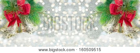Two Christmas Bells Decoration On Festive Lights
