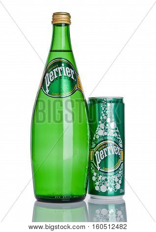 LONDON UK - DECEMBER 06 2016: Bottle and tin of Perrier sparkling water. Perrier is a French brand of natural bottled mineral water sold worldwide.