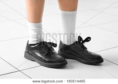 Feet of schoolgirl in uniform, close up view