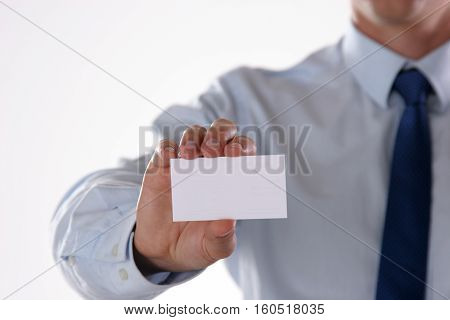 Unknown busineness man with card on white background.