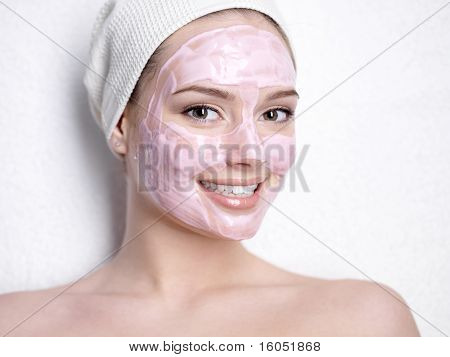 Smiling Woman With Facial Mask