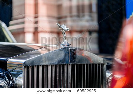 PARIS FRANCE - SEP 12 2016: Emblematic and Exclusive Luxury Rolls-Royce car limousine parked in city during fashion wedding vip event waiting for passenger. Rolls-Royce Limited is a British car-manufacturing