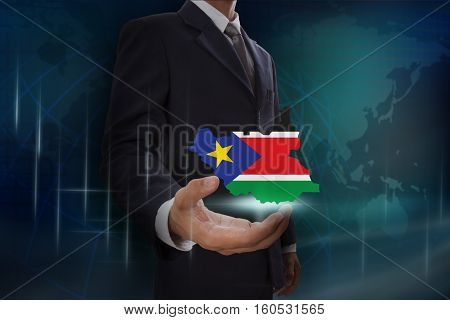 Businessman showing map of South Sudan on globe background