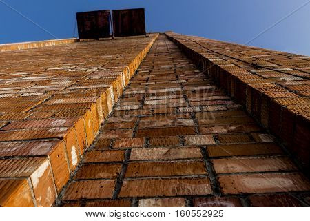 Brickwork. Grunge brick wall. Rough brick wall. Grunge brick background. Wall of a large brick house