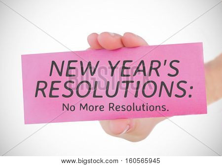 Hand holding a card with new year resolution goals against white background