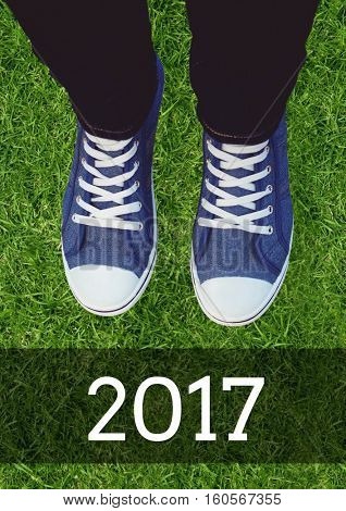 2017 new year wishes with teenager wearing sneakers against grass background