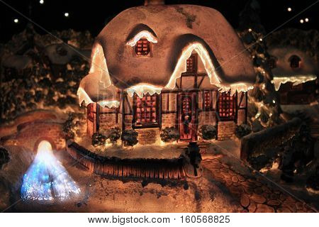 Lighted Christmas house in a dark holy night