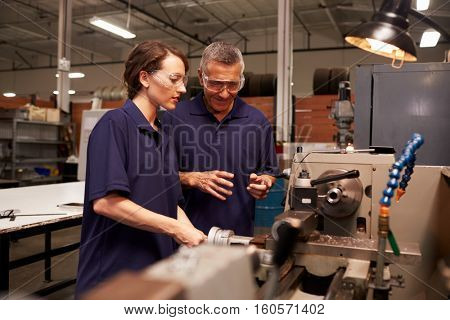 Engineer Training Female Apprentice On Milling Machine