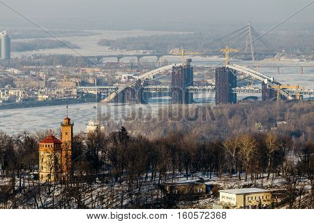 Top View of the Dnipro park and Podolsky bridge in Kiev, Ukraine  in winter day.