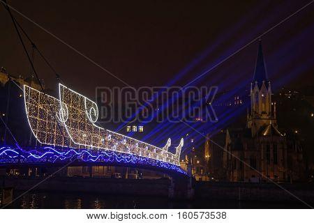 Lyon, France, December 7, 2016 : A Light Boat On The Pedestrian Bridge Over Saone River. The Festiva