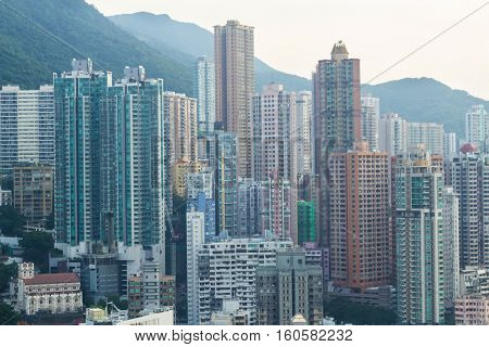 Modern tall residential buildings in sleeping area near mountain in Hong Kong, China, view from China Merchants Tower