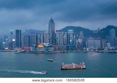 Evening high skyscrapers, river and ships in Hong Kong, China, view from Starhouse