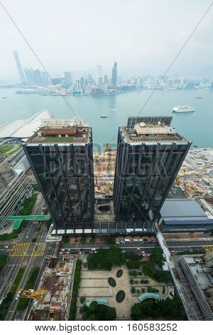 Glass buildings, sea shore in Hong Kong city, China at sunny day, above view from China Resources Building