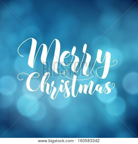 Merry Christmas greeting card. Modern calligraphy lettering. Typographic vector design, beautiful blue bokeh background, blurred festive lights.