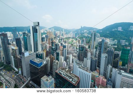 Skyscrapers, buildings, mountains in Hong Kong city, China at summer, view from from China Resources Building