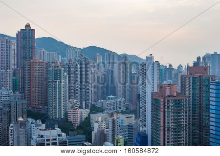 Skyscrapers and modern tall residential buildings and mountains in Hong Kong, China, view from China Merchants Tower