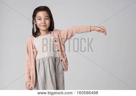 East asian girl studio portrait - isolation