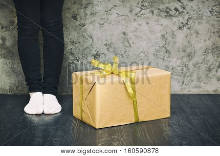 One present near woman's legs