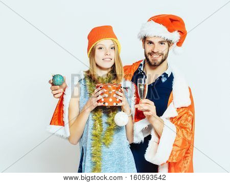 Cheerful Couple In Santa Suits