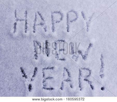 Written words happy new year on white snowy background
