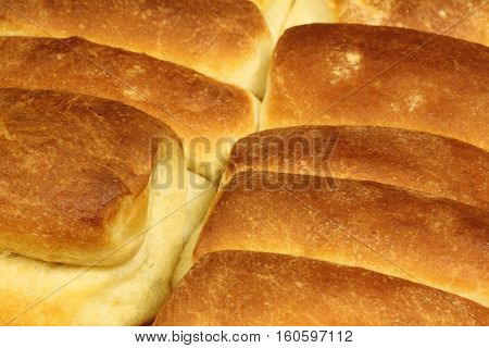 Homemade baked bread buns close up background