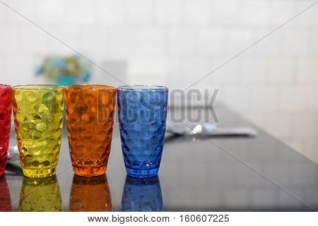 Colorful Glass, Spoon, Fork On Table In Restaurant