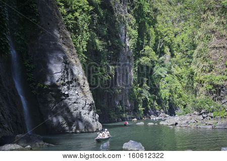 tourists travelling down pagsanjan river to the falls in lagunanear manila luzon philippines