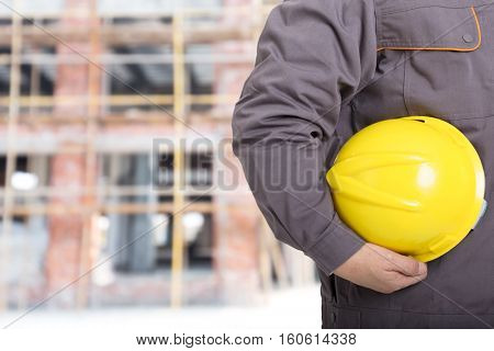 old asian man engineer with new construction site