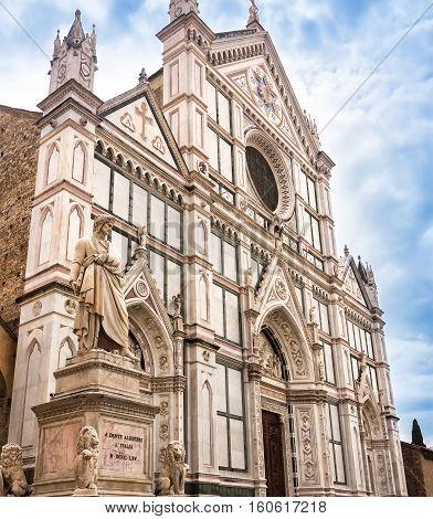 Statue of Dante Alighieri in the Piazza Santa Croce besides the Basilica of Santa Croce in Florence Italy.