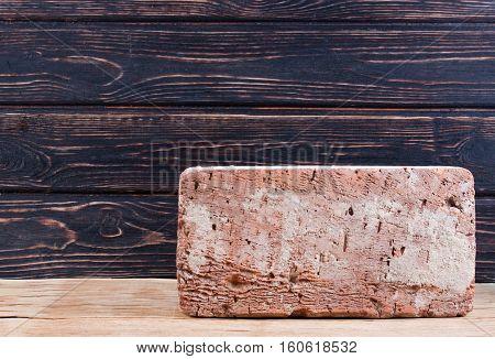 Old brick on wood desk. Concept building