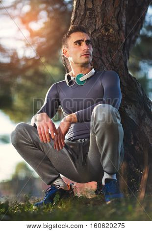 Handsome man exercising in forest on sunny day