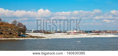 HELSINKI, FINLAND - APRIL 10, 2010: View of Helsinki with The City Cathedral and ferry boats from the Gulf of Finland and Suomenlinna (Sveaborg) Fortress